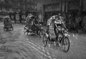 PhotoVivo Honor Mention e-certificate - Wendy Wai Man Lam (Hong Kong)  Rickshaw In The Rain Bw