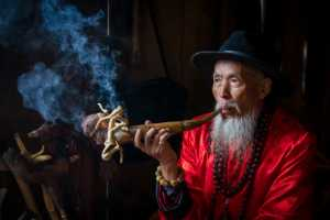 PhotoVivo Gold Medal - Shihong Ding (China)  Man With Smoke