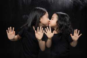 PhotoVivo Gold Medal - Junyong Jin (China)  Closed Sisters