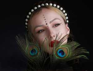 ICPE Gold Medal - Qianming Zhang (China)  Peacock Girl
