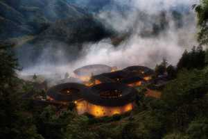 PhotoVivo Gold Medal - Yun Xiao (China)  Tulou Buildings In The Clouds